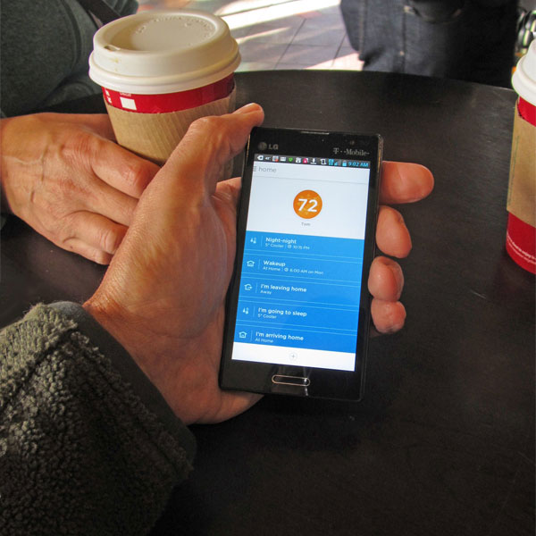 Adjusting the Lyric thermostat using a cell phone in a coffee shop