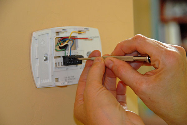 Removing old thermostat from the wall